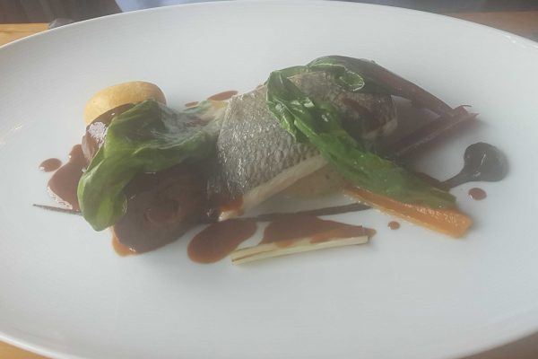 Fillet of bass with braised oxtail and rainbow chard